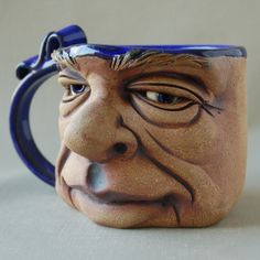 face mug by Herksworks on Etsy, $40.00