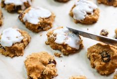 Cakey cookies are topped with silky icing. You won't believe these paleo Pumpkin Raisin cookies are grain and dairy free.
