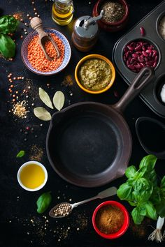 Frying pan empty and assorted spices Free Photo