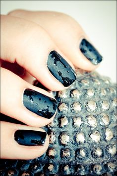 Matte polish. Put a bit of gloss top coat (or a color?) on a surface, and apply dripping design with a straightened bobby pin.