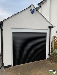 Aluminium garage doors from Garolla come in a variety of different shades. An electric roller door in black is effortlessly stylish. To find out more about our best roller shutter garage doors, click the link. Black Garage Doors, Garage Door Paint, Garage Door Colors, Electric Garage Doors, Garage Door Decor, Garage Door Makeover, Garage Door Design, Roller Doors, Roller Shutters