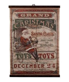 Santa is on a Grand Expedition bringing fancy goods, novelties and of course toys, toys, toys! Add a vintage touch to your Christmas decorating with this fun traveling Santa sign. - Aged paper and met