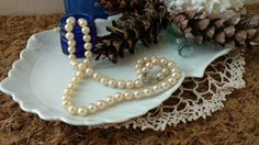 Check out this item in my Etsy shop https://www.etsy.com/listing/226995004/antique-pearl-necklace-by-alice-caviness