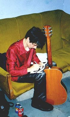 A rare image of Matthew Bellamy with an actual accoustic guitar