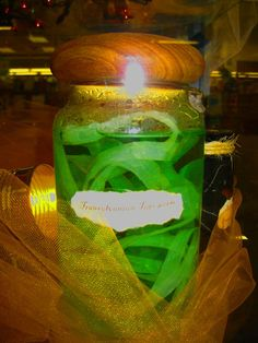 Transylvanian Tapeworm: Just smear hot glue about 1/4 inch wide down wax paper. You can even glue several pieces together. Cut out when as long as desired and add eyes and mouth with nail polish. Place in jar. Add water and a little green food coloring.