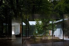 Megumi Matsubara and Hiroi Ariyama have completed a house in the forest of Karuizawa, Nagano, arranged around five courtyards.
