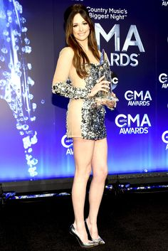 Kacey Musgraves told reporters that she had to rip her stick-on underwear off at the 2014 CMA Awards on Wednesday, Nov. 6, in Nashville; read all about her wardrobe malfunction