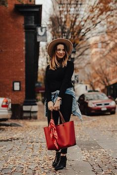 Black on black with a pop of red in our Rachel leather tote. via @ erinkrespan