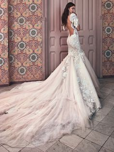 Galia Lahav backless, off the shoulder wedding dress with embroidered detail with sequin fringes, hand embroidered lace, 3-Dtulle appliqués, 3-D rose appliqués, French lace flounce.http://www.confettidaydreams.com/galia-lahav-2018/