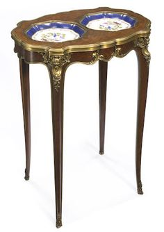 A Louis XV style gilt bronze mounted parquetry inlaid kingwood occasional table <br>fourth quarter 19th century
