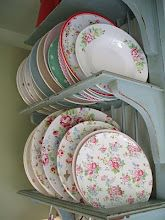 """Tea Party"" china is really appealing to me today! What a pretty way to store/display dishes!"