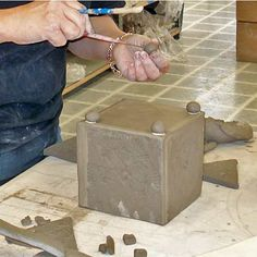 When attaching feet onto slab clay box, be sure to seal the clay edges!