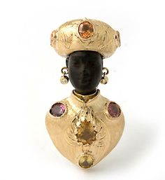 """18 kt. gold """"Moretto Scudo"""" brooch set with colored sapphires, and diamonds."""