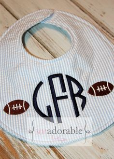 It's football season and this adorable monogrammed baby bib is perfect for your little one to show their team spirit! It can be custom made in any team colors for boy or girl. This would also make a wonderful baby shower gift that every mom to be (and DAD!) is sure to love! #monogrammed #football #babyshower