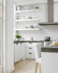 These counters are beautiful and bring a unique look to the very white kitchen. If anyone knows what kind of material that is let me know! Via nest egg (nestegg.typepad.com).