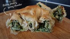 Albanian recipe: Spinach & Cheese Byrek Albanian: Byrek me Spinaq dhe çedër  Byrek in Albania can be made with homemade or ready made, pre-rolled filo pastry, personally I find that this works better with the ready made. The name 'Byrek' is one of a few, some will call it Borek, Burek or even Pite (when made as a whole pie instead of individual batches).  I love making these for lunch, they are even the perfect size for packed lunches.