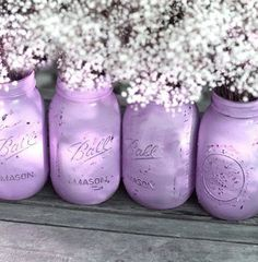 centerpieces - Baby's breath in mason jar, spray paint mason jar with purple glitter spray paint