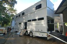 Travel in style....Aussie firm creates the largest-ever horse trailer, which sleeps six, boasts a lounge and kitchen and has room for 14 horses.