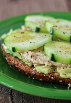 Healthy Snacks Cucumber Hummus Avocado Toast, lo pro bread and zuchinni hummus - Crunchy cukes, creamy hummus, and glorious avocado join forces in pretty much the easiest lunch or snack ever. Think Food, I Love Food, Food For Thought, Avocado Toast, Avocado Hummus, Vegetarian Recipes, Cooking Recipes, Healthy Recipes, Simple Recipes