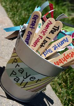 Prayer Pail...great idea for prayer intentions or to pray specific prayers. Sticks could include basic Catholic prayers as an alternate idea.
