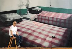 Zhang Xiaogang in his Beijing studio; in the background, his Green Wall
