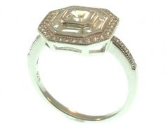 Sterling silver ring with square cut CZ surrounded baguette and round CZ.