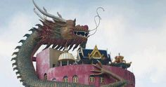 At Wat Samphran (วัดสามพราน) in Nakhon Pathom Province there is a 17 storey building that has a giant dragon climbing to t...