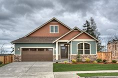 The exterior of the Purcell home by Lennar, with a fun color palette.