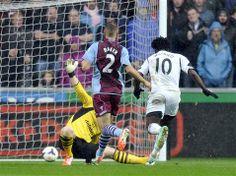 Swansea City 4 Aston Villa 1: Wilfried Bony deftly opens the scoring despite the torrential downpour.