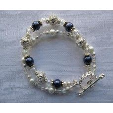 """""""Kiss The Stars"""": Silver, pearls, glass and a touch of navy lights up the sky   Silver toggle clasp   7"""" length   $48"""