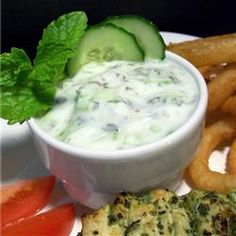 Cucumber Raita Recipe Appetizers, Side Dishes, Condiments and Sauces, Salads with cucumber, greek yogurt, lemon juice, chopped fresh mint, white sugar, kosher salt