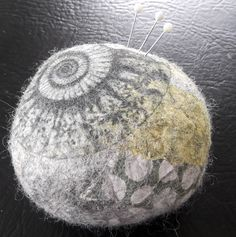 Ammonite Fossil Felt Pebble pin cushion.