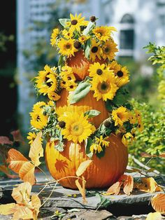 I'm not sunflower fan but I love the idea of putting flowers with stacked pumpkins.  Really festive for fall!
