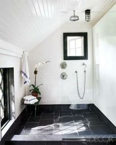 open shower with slanty ceiling
