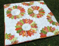 Double-ended point Dresden Plate quilt in bright colours.