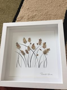 Weizen Kiesel Kunst Wheat pebble art modern contemporary style pebble art framed by me in 99 white shadow box as shown sure to compliment any style decor. Thanks for your interest The post Weizen Kiesel Kunst appeared first on Diy Flowers. Stone Crafts, Rock Crafts, Diy Arts And Crafts, Sea Glass Crafts, Sea Glass Art, Rock And Pebbles, Pressed Flower Art, Sea Art, Art Moderne