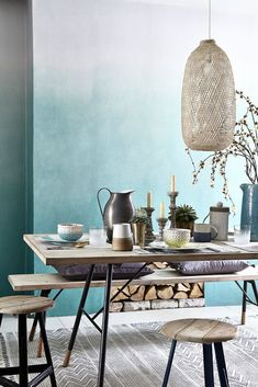 Let the watery hue of a sea green wallpaper transport you to sunny shores -  a perfect scheme for relaxed dining. Photography: Mark Scott. Find more dining room ideas at housebeautiful.co.uk