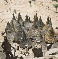 Africa | Thatch-covered conical roofs of cylindrical houses in a Matakam compound, Cameroon. | ©Rene Gardi