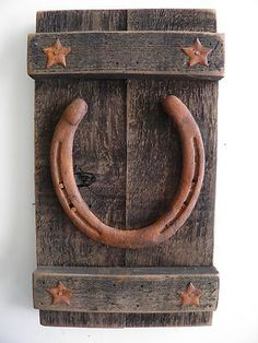 Just sold on Ebay. Rusty horseshoes and stars on barnwood ~ wall decor