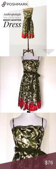 """Anthropologie We Love Vera Berry Months Dress Adorable fit & flare dress w/ a cream colored background & allover lush green leafy print finished off with a giant strawberry print at the bottom hem. Coordinating green fabric belt. Adjustable & removable shoulder straps. Side zipper w/ hook & eye closure. Bodice has boning, an inner no slip grip strip & back elastic panel. Fully lined. Outer fabric is 100% rayon, lining is 100% acetate. Length from top of bodice to bottom hem is 33"""", bust is…"""