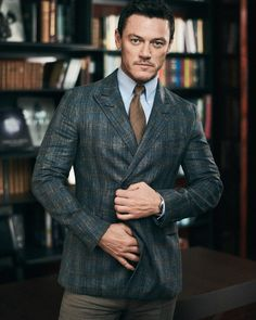 Donning a double-breasted jacket by Dunhill, Luke Evans also wears a Turnbull & Asser shirt, Drake's tie, and Brunello Cucinelli trousers. Luke Evans, Jonathan King, Private Life, Double Breasted Jacket, Raining Men, Perfect Man, Sexy Men, Hot Guys, Actors