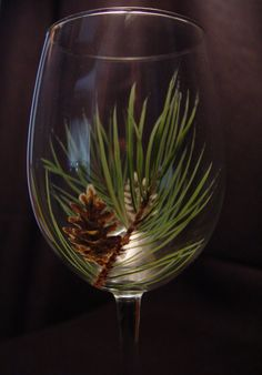 This Pine Cone design wine glass is hand painted and available on Etsy.com by BloominStemware. If you don't see it listed, make a special order.