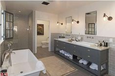 slate-colored vanity / taupe subway tiles