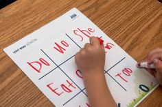 "A  young student plays ""Sight Word Tic-Tac-Toe"" at a PTA Family Reading Experience. Learn more at PTA.org/FamilyReading"
