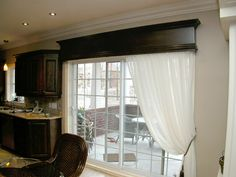 Build a wooden valance box - but in white - for the family room sliding door.