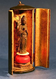 Little Wooden Buddhist Shrine… the doors opening to reveal a gilt interior fitted with a carved figure of Buddha standing on an ivory platform, 19th c.