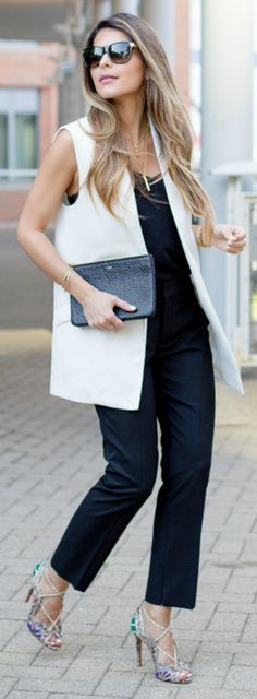 Pam Hetlinger is looking stylish in a white vest jacket and black trousers!  Vest: Mango, Top: Express, Heels: Schutz
