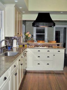 White cabinets with oil rubbed bronze hardware and hinges for White bathroom cabinets with bronze hardware