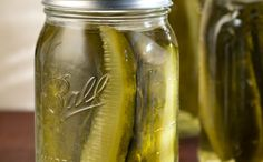 Canning Dill Pickles - non polish  HOT BRINE:  3 cups water  1/4 cup pickling salt  2 cups white vinegar  1 dill weed sprig  2 cloves garlic  Quart size wide mouth canning jars, sterilized, cooled  5-6 cucumbers, medium