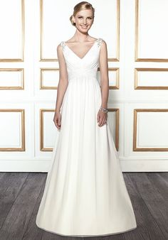 Simple but glamorous describes this A-line gown with a V-neck. Beaded motifs embellish the shoulder straps.